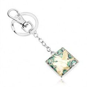 Šperky eshop - Kľúčenka v štýle cabochon, štvorec s čírou glazúrou, dve biele holubice, lístky SP53.01