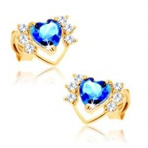 Šperky eshop - Náušnice v žltom 14K zlate - tenká kontúra srdca so zirkónmi, modrý topás GG88.34