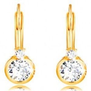 Šperky eshop - Náušnice zo žltého 14K zlata - väčší okrúhly zirkón v objímke a drobný zirkónik GG210.12