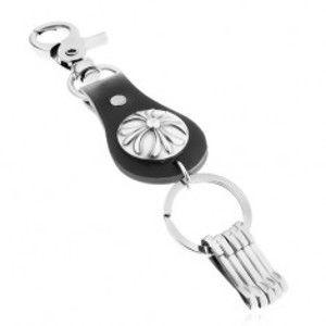 Šperky eshop - Patinovaný prívesok na kľúče v tmavosivom odtieni, ľaliový kríž v kruhu Y36.10