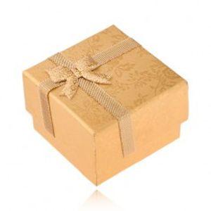 Šperky eshop - Zlatá krabička na prsteň zdobená stužkou a mašľou, zlaté ruže UY15