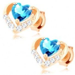Šperky eshop - Zlaté náušnice 375 - modré topásové srdiečko v ligotavej kontúre GG62.27