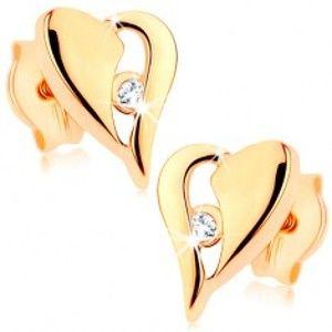 Šperky eshop - Zlaté náušnice 375 - nesúmerné srdce s výrezom a drobným zirkónikom GG76.09