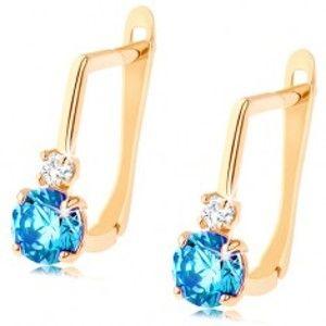 Šperky eshop - Zlaté náušnice 585 - okrúhly syntetický topás modrej farby, číry zirkónik GG94.02